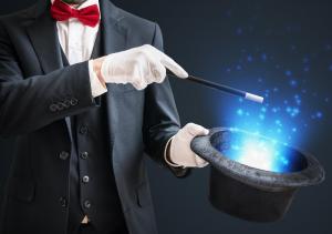 Magicien tenant une baguette magique